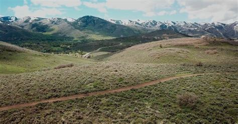 Drone Footage Of A Person Traveling The Land Using Bike